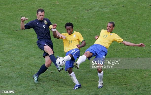 Ze Roberto Gilberto Silva of Brazil and Mark Viduka of Australia stretch for the ball during the FIFA World Cup Germany 2006 Group F match between...