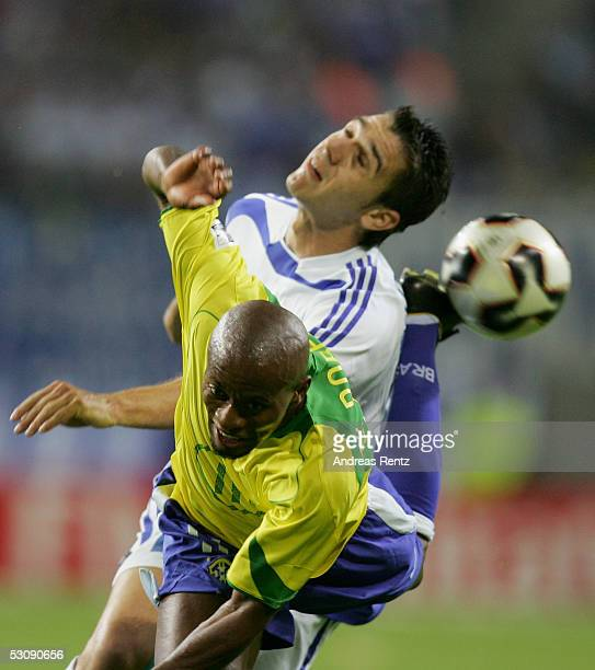Ze Roberto of Brazil challenges with Ioannis Goumas of Greece during the FIFA Confederations Cup 2005 match between Brazil and Greece on June 16 2005...