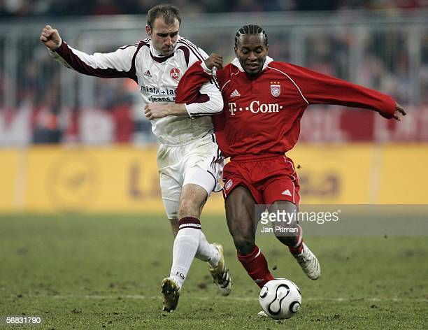 Ze Roberto of FC Bayern Munich and Robert Vittek of 1 FC Nuremberg battle for the ball during the Bundesliga match between FC Bayern Munich and 1 FC...