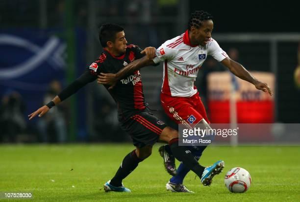 Ze Roberto of Hamburg and Arturo Vidal of Leverkusen battle for the ball during the Bundesliga match between Hamburger SV and Bayer Leverkusen at...
