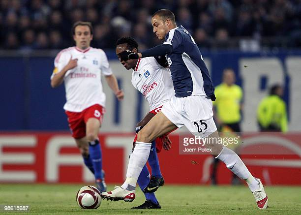 Ze Roberto of Hamburg and Bobby Zamora of Fulham compete for the ball during the UEFA Europa League semi final first leg match between Hamburger SV...
