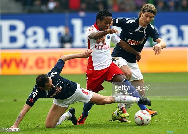 Ze Roberto of Hamburg and Martin Lanig of Koeln battle for the ball during the Bundesliga match between Hamburger SV and 1 FC Koeln at Imtech Arena...