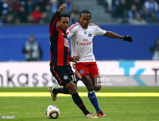 Ze Roberto of Hamburg and Raffael of Berlin compete for the ball during the Bundesliga match between Hamburger SV and Hertha BSC Berlin at HSH...