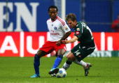 Ze Roberto of Hamburg and Thorben Marx of Gladbach battle for the ball during the Bundesliga match between Hamburger SV and Borussia M'gladbach at...