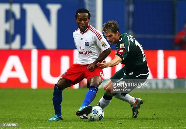 Ze Roberto of Hamburg and Thorben Marx of Gladbach battle for the ball during the Bundesliga match between Hamburger SV and Borussia M'gladbach at...