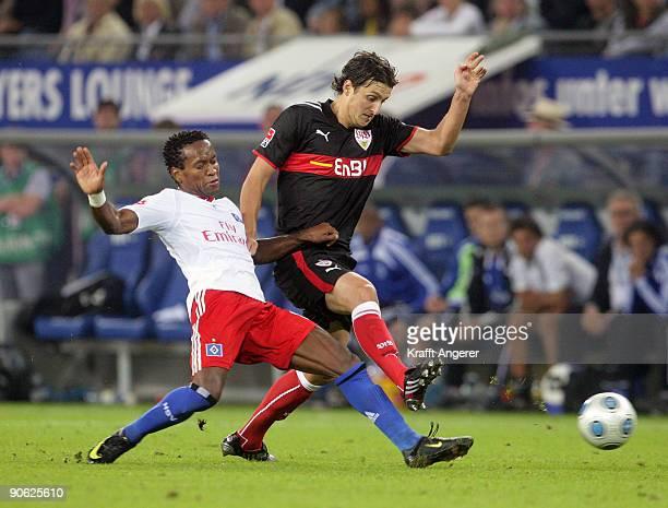 Ze Roberto of Hamburg battles for the ball with Zdravko Kuzmanovic of Stuttgart during the Bundesliga match between Hamburger SV and VfB Stuttgart at...