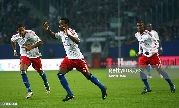 Ze Roberto of Hamburg celebrates after scoring his team's 2nd goal during the Bundesliga match between Hamburger SV and Borussia M'gladbach at the...