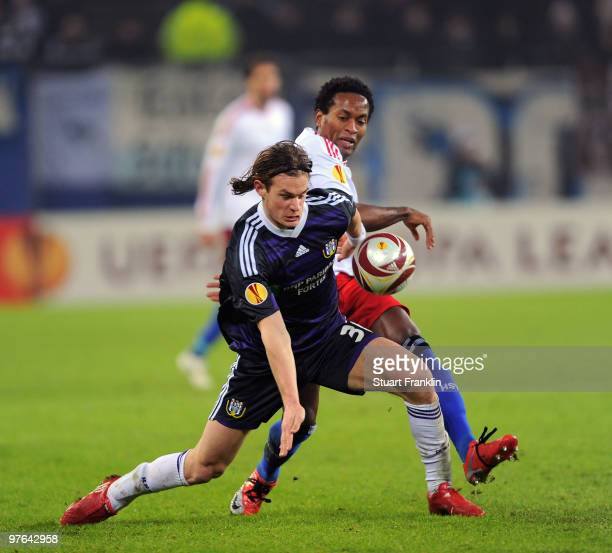 Ze Roberto of Hamburg is challenged by Guillaume Gillet of Anderlecht during the UEFA Europa League round of 16 first leg match between Hamburger SV...