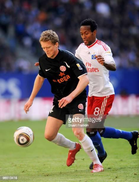 Ze Roberto of Hamburg is challenged by Nikolce Noveski of Mainz during the Bundesliga match between Hamburger SV and FSV Mainz 05 at HSH Nordbank...