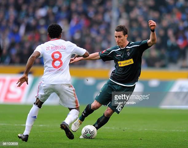 Ze Roberto of Hamburg is challenged by Rob Friend of Gladbach during the Bundesliga match between Borussia Moenchengladbach and Hamburger SV at...