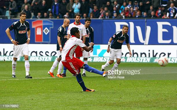 Ze Roberto of Hamburg scores his team's 6th goal during the Bundesliga match between Hamburger SV and 1 FC Koeln at Imtech Arena on March 19 2011 in...
