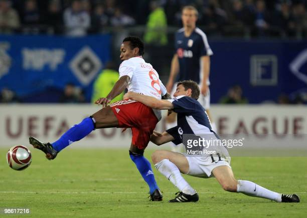 Ze Roberto of HSV is challenged by Zoltan Gera of Fulham during the UEFA Europa League semi final first leg match between Hamburger SV and Fulham at...