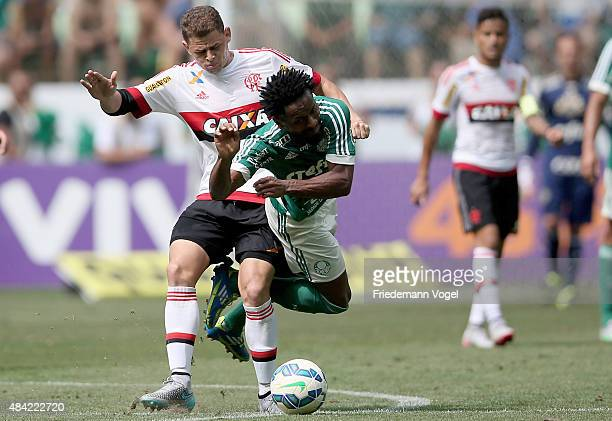 Ze Roberto of Palmeiras fights for the ball with Jonas of Flamengo during the match between Palmeiras and Flamengo for the Brazilian Series A 2015 at...
