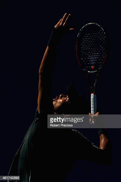 Ze Zhang of China serves in his match against Illa Marchenko of Ukraine during qualifying for the 2014 Australian Open at Melbourne Park on January...