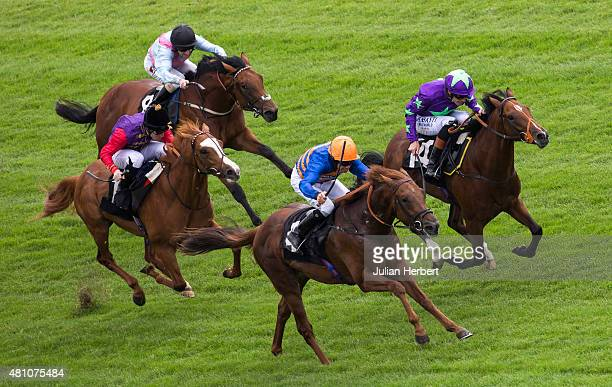Zebadiah ridden by Richard Hughes gets the better of Equistar ridden by Timmy Murphy to win The Highclere Thoroughbred Racing EBF Stallions Maiden...