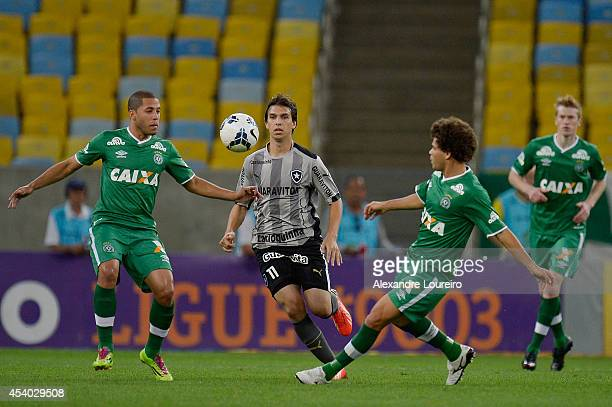 Zeballos of Botafogo battles for the ball with Wanderson and Camilo of Chapecoense during the match between Botafogo and Chapecoense as part of...