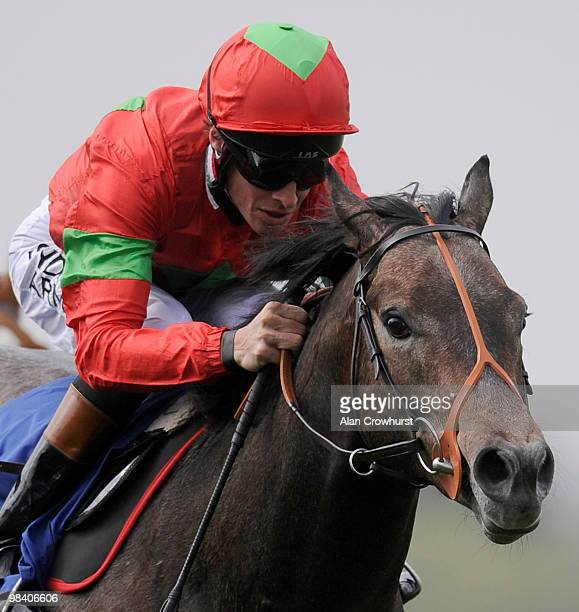 Zebedee and Richard Hughes win The European Breeders' Fund Maiden Stakes at Windsor racecourse on April 12 2010 in Windsor England