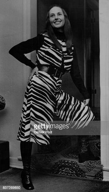 A zebra pattern of black and white fake fur is the choice of MrsDwain Bond for her gaucho suit She will model it for other auxiliary members Thursday...