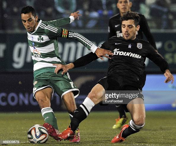 Zeca of Panathinaikos is tackled by Kostas Katsouranis of PAOK during the Greek Superleague between Panathinaikos and PAOK at the Apostolos...