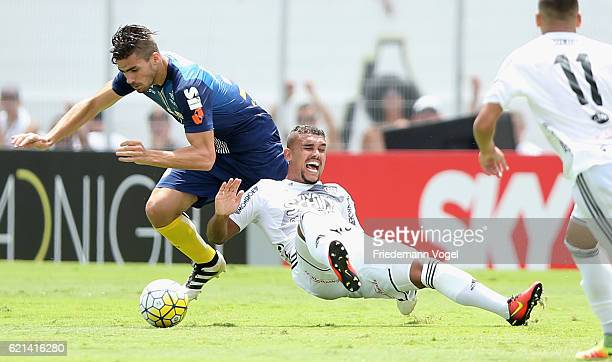 Zeca of Santos fights for the ball with Pottker of Ponte Preta during the match between Ponte Preta and Santos for the Brazilian Series A 2016 at...