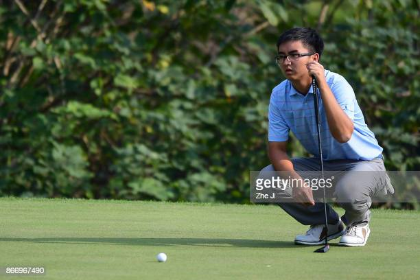 Zecheng Dou of China lines up a putt on the 17th green during the second round of the WGC HSBC Champions at Sheshan International Golf Club on...