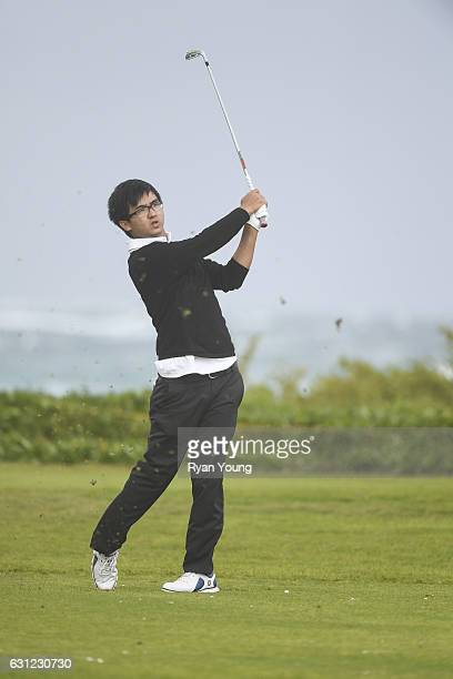 Zecheng Dou tees off on the 14th hole during the first round of The Bahamas Great Exuma Classic at Sandals Emerald Reef Course on January 8 2017 in...