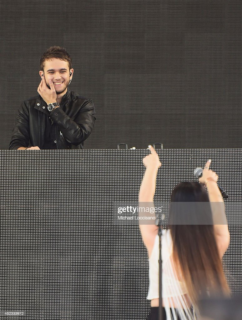 <a gi-track='captionPersonalityLinkClicked' href=/galleries/search?phrase=Zedd+-+Musician&family=editorial&specificpeople=5830568 ng-click='$event.stopPropagation()'>Zedd</a> and singer <a gi-track='captionPersonalityLinkClicked' href=/galleries/search?phrase=Miriam+Bryant&family=editorial&specificpeople=10134771 ng-click='$event.stopPropagation()'>Miriam Bryant</a> perform on ABC's 'Good Morning America' at Rumsey Playfield, Central Park on July 18, 2014 in New York City.