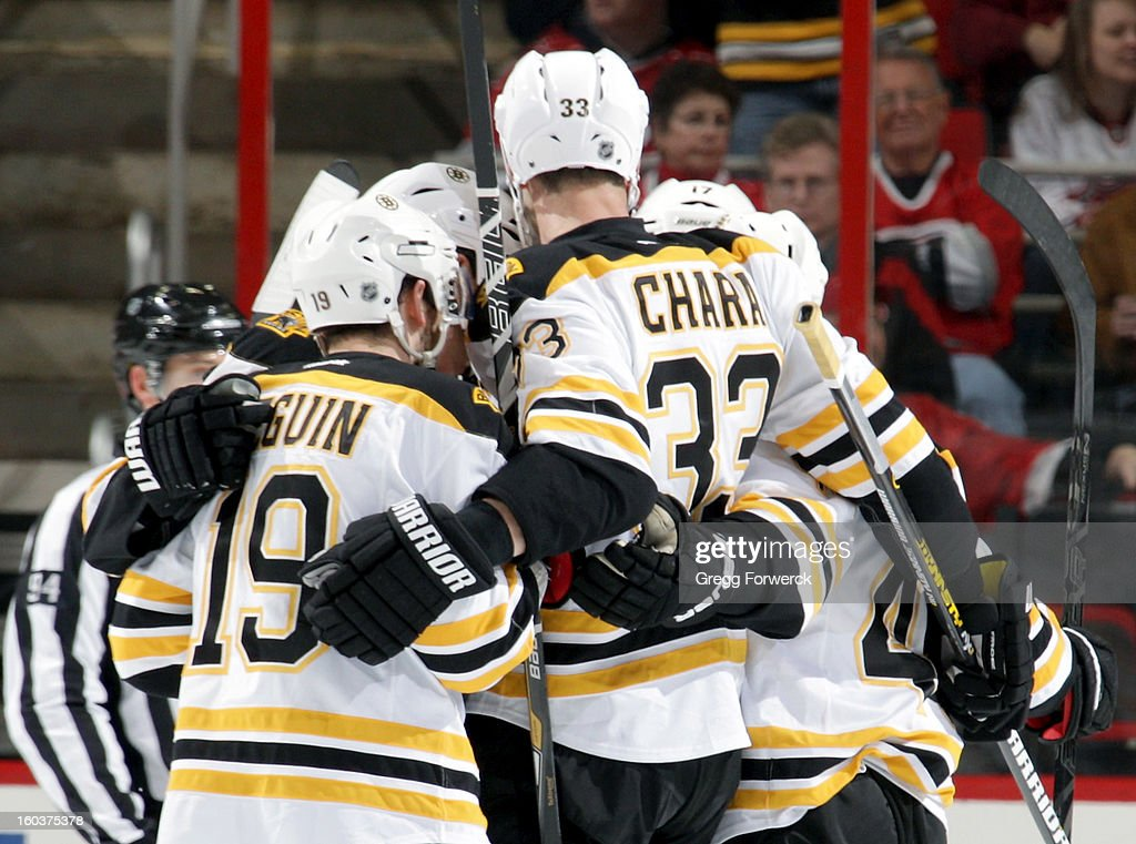 Zedeno Chara #33 of the Boston Bruins and teammate Tyler Seguin #19 celebrate with fellow Bruins after scoring a goal in the 2nd period during their NHL game against the Carolina Hurricanes at PNC Arena on January 28, 2013 in Raleigh, North Carolina.