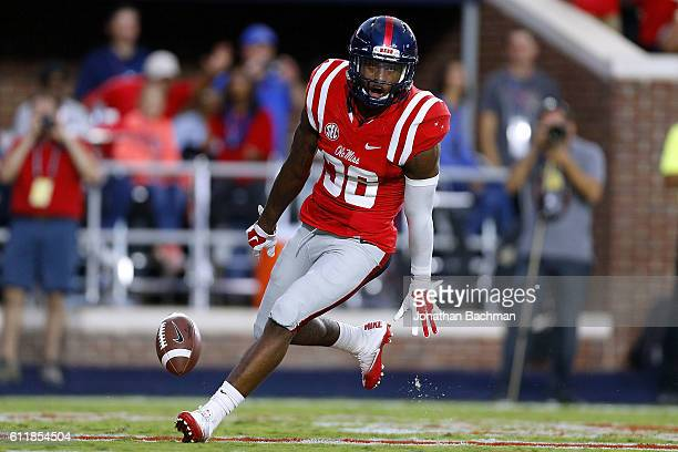 Zedrick Woods of the Mississippi Rebels returns an interception for a touchdown during the first half of a game against the Memphis Tigers at...
