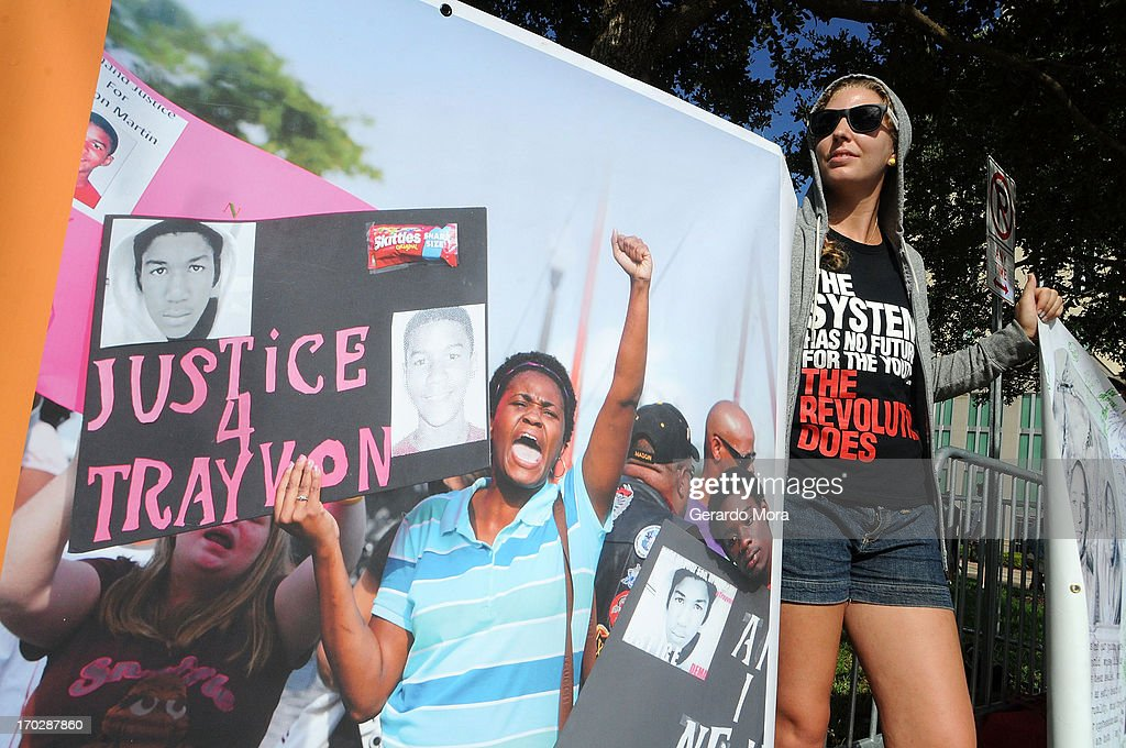 Zee of Atlanta, member of the Revolutionary Communist Party supports Trayvon Martin's family outside the Seminole County Courthouse during the first day of trial for George Zimmerman on June 10, 2013 in Sanford, Florida. Jury selection will begin today as Zimmerman is charged with the second-degree murder of an unarmed teenager, Trayvon Martin.