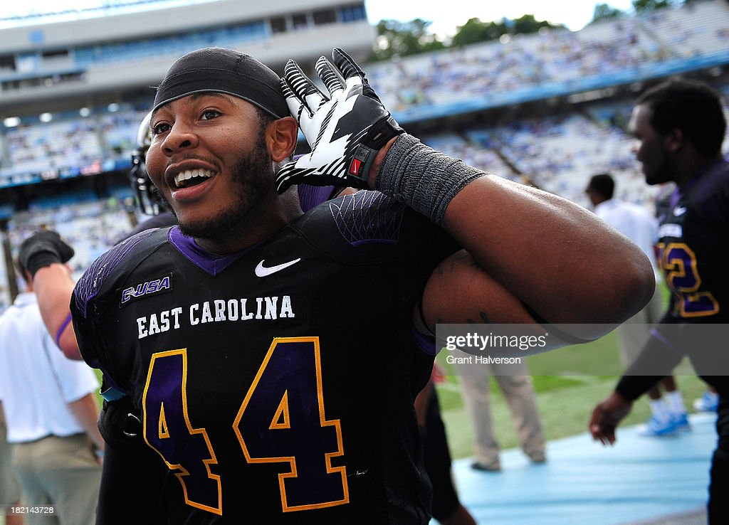 Zeek Bigger #44 of the East Carolina Pirates looks to the fans during the final seconds of a win over the North Carolina Tar Heels at Kenan Stadium on September 28, 2013 in Chapel Hill, North Carolina. East Carolina won 55-31.