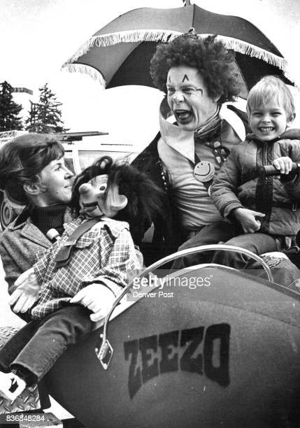 Zeezo the Clown helps to Promote 'Honey Sunday' Zeezoreally Larry Campbell of Denver holds Greg West 6239 S Marion St Littleton as Mrs Campbell and...
