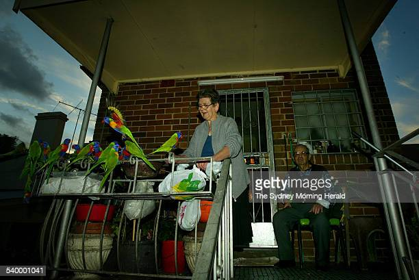 Zefi and George who feed the birds daily from their back verandah at their Rozelle home 19 May 2006 SMH NEWS Picture by SAHLAN HAYES