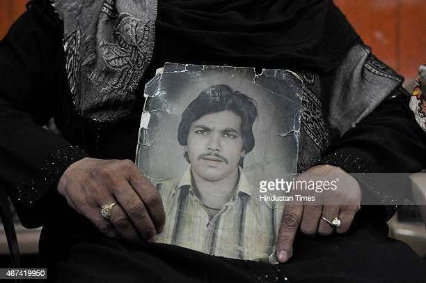 Zehbunisha shows picture of her husband wife of Mohd Iqbal who was killed in 1987 Hashimpura massacre during a press conference to express their...