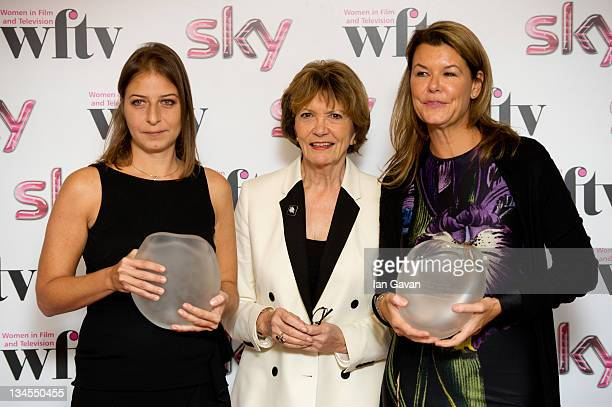 Zeina Khodr and Alex Crawford pose with the ITV Achievement of the Year Award with presenter Joan Bakewell during the Women In Film And TV Awards...