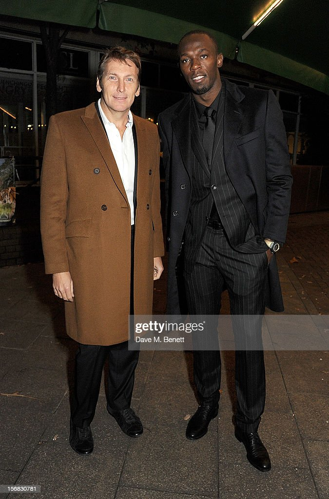 Zeitz Foundation founder Jochen Zeitz (L) and Olympic athlete Usain Bolt arrives at the Zeitz Foundation and ZSL Gala at London Zoo on November 22, 2012 in London, England.