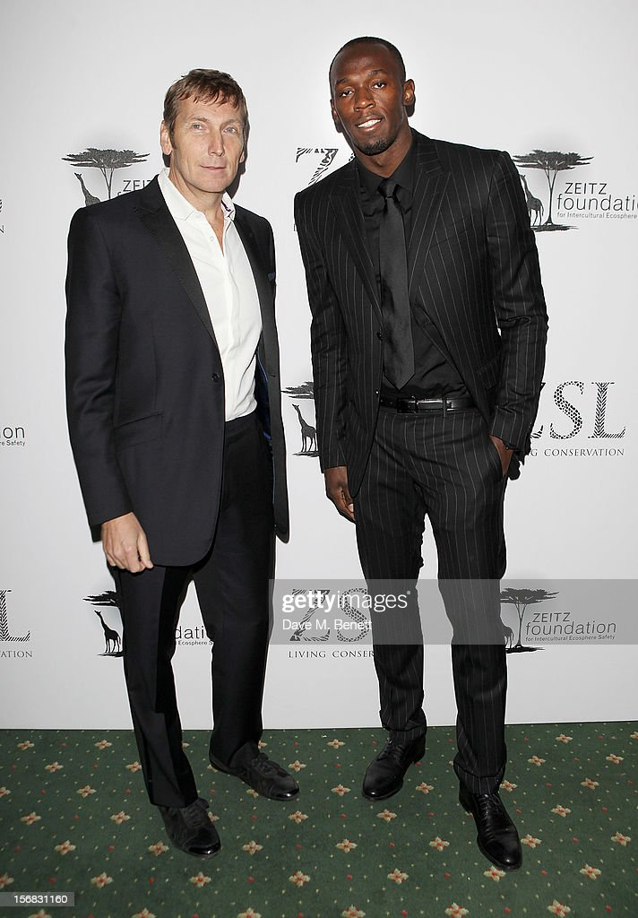 Zeitz Foundation founder Jochen Zeitz (L) and Usain Bolt arrive at the Zeitz Foundation and ZSL Gala at London Zoo on November 22, 2012 in London, England.