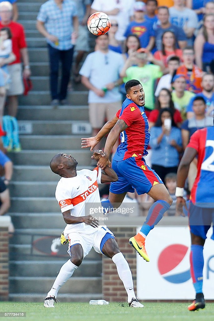 Zeki Fryers of Crystal Palace FC wins control of a loose ball over Omar Cummings of FC Cincinnati during the match at Nippert Stadium on July 16 2016...