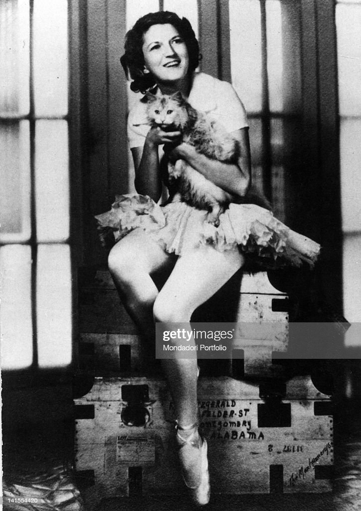 Zelda Sayre, wife of Francis Scott Fitzgerald, dressing up as a ballet dancer and holding a cat . 1928
