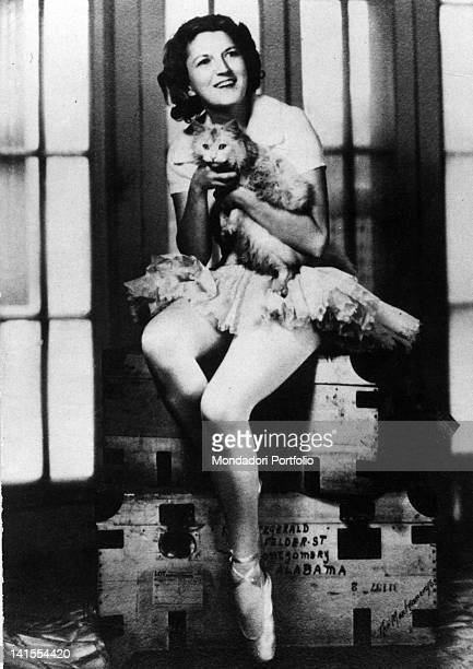 Zelda Sayre wife of Francis Scott Fitzgerald dressing up as a ballet dancer and holding a cat 1928