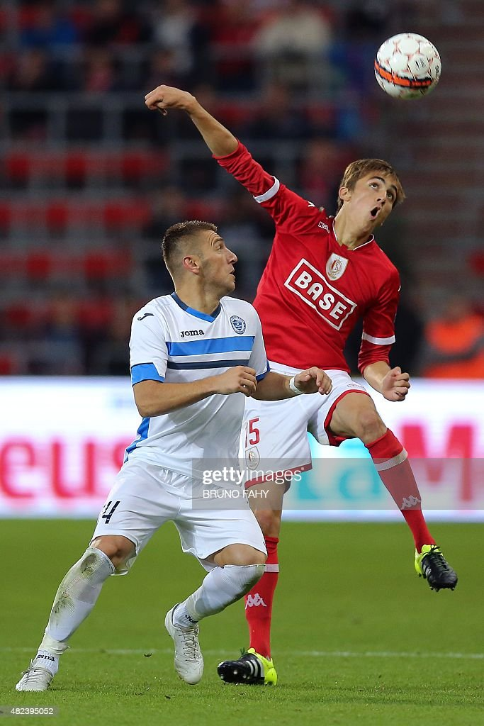Zeljeznicar's Dino Hasanovic and Standard's Julien De Sart vie for the ball during the UEFA Europa League third qualifying round footbal match...