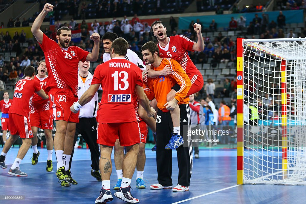 Zeljko Musa, Zlatko Horvat, Mirko Aillovic and Domagoj Duvnjak of Croatia celebrate after the Men's Handball World Championship 2013 third place match between Slovenia and Croatia at Palau Sant Jordi on January 26, 2013 in Barcelona, Spain. The match between Slovenija and Croatia ended 26-31.