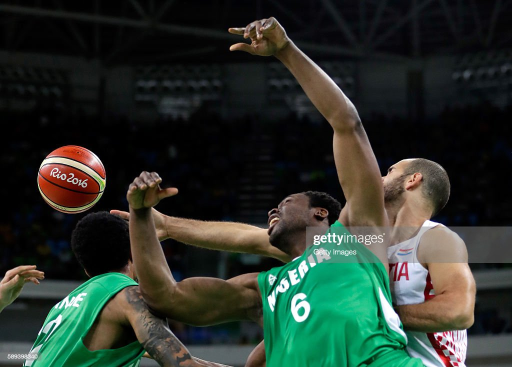 Zeljko Sakic of Croatia and Ike Diogu of Nigeria battle for a rebound during the preliminary round game at the Rio 2016 Olympic Games on August 13...