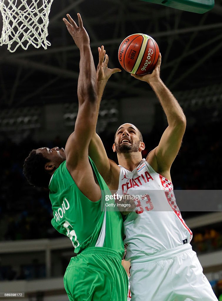 Zeljko Sakic of Croatia shoots as Ike Diogu of Nigeria defends during the preliminary round game at the Rio 2016 Olympic Games on August 13 2016 in...