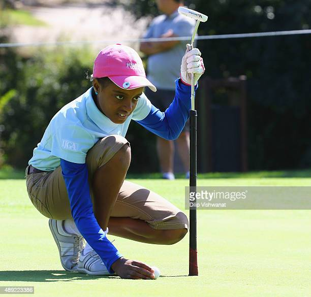 Zell Wilson lines up a putt in the girls 1011 division putting contest during the 2015 Drive Chip and Putt Tournament at Medinah Country Club on...