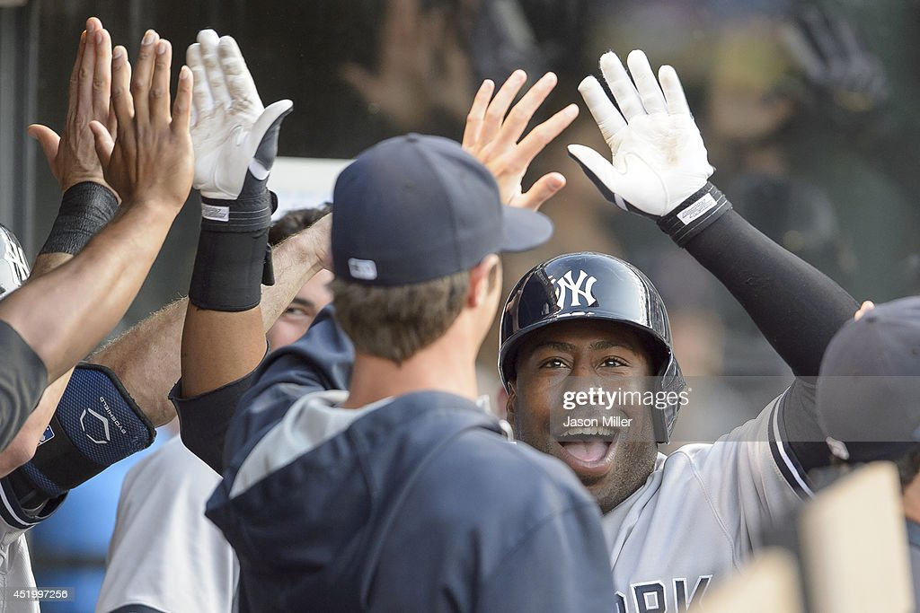 Zelous Wheeler #45 of the New York Yankees celebrates in the dugout after he hit a two run home run during the fourth inning against the Cleveland Indians at Progressive Field on July 10, 2014 in Cleveland, Ohio.