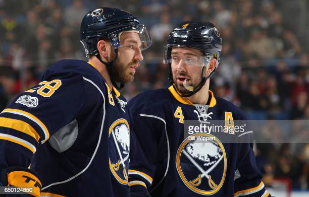 Zemgus Girgensons and Josh Gorges of the Buffalo Sabres talk during an NHL game against the Arizona Coyotes at the KeyBank Center on March 2 2017 in...