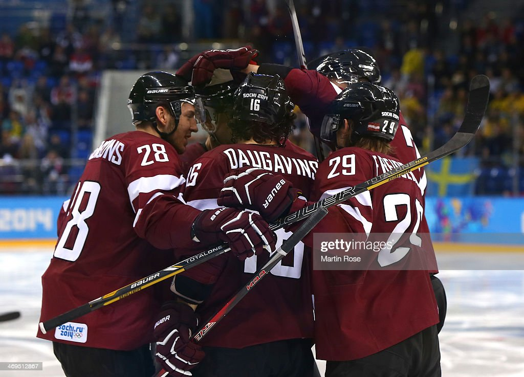 Zemgus Girgensons #28 of Latvia celebrates with teammates after scoring in the third period against Sweden during the Men's Ice Hockey Preliminary Round Group C game on day eight of the Sochi 2014 Winter Olympics at Shayba Arena on February 15, 2014 in Sochi, Russia.