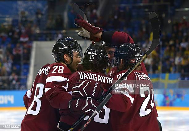 Zemgus Girgensons of Latvia celebrates with teammates after scoring in the third period against Sweden during the Men's Ice Hockey Preliminary Round...