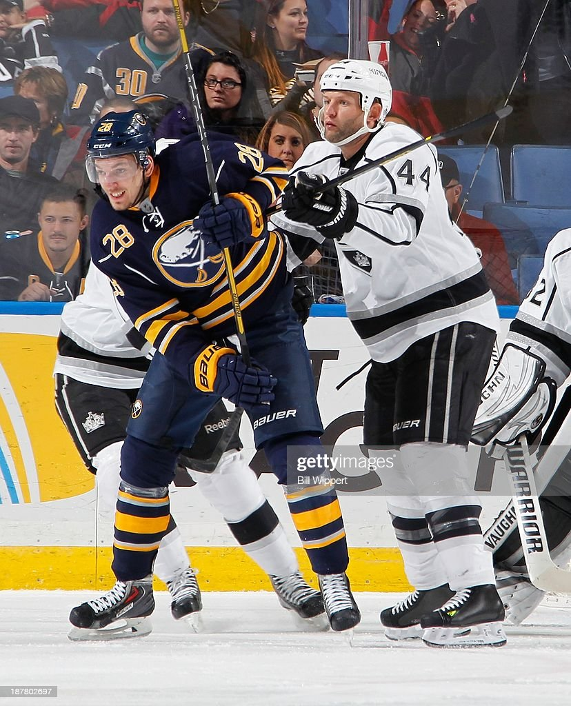 Zemgus Girgensons #28 of the Buffalo Sabres battles for position in front of the net against Robyn Regehr #44 of the Los Angeles Kings on November 12, 2013 at the First Niagara Center in Buffalo, New York.